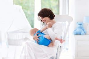 """""""If breastfeeding is so natural, why is it so hard?"""" We've all seen the pictures of the blissfully content mother cradling her infant at her breast. And isn't it true that they are usually in a rocking chair? Would your picture show a miserable mother and miserable baby? Do You Have Too Much Breast Milk? You may have too much breast milk if: · You always feel engorged. · You go through bra pads like there is no tomorrow because you leak so much, all the time. · You get plugged ducts again and again. · Maybe you've gotten mastitis. · Your baby is fussy or cries when she breastfeeds. · Your baby chokes and sputters when your milk lets down. · She may come off the breast when your milk first lets down. · Your milk sprays everywhere. · She is very gassy. · Clicking sounds may be heard when she sucks. · She spits up all the time, especially right after feedings. · She has green poops most of the time. · She clamps down on your breast during feedings. o This can cause sore nipples. · She feeds for very short periods of time. · She may want to eat very frequently most of the time. · Yet, she may be struggling to gain enough weight. · Or, your baby gains weight rapidly · You pump large amounts of milk, even if you have just fed. Seriously, you need another freezer! · Feedings are NO FUN! · (Source). If you've agreed with several of these statements, you may have an oversupply of milk."""