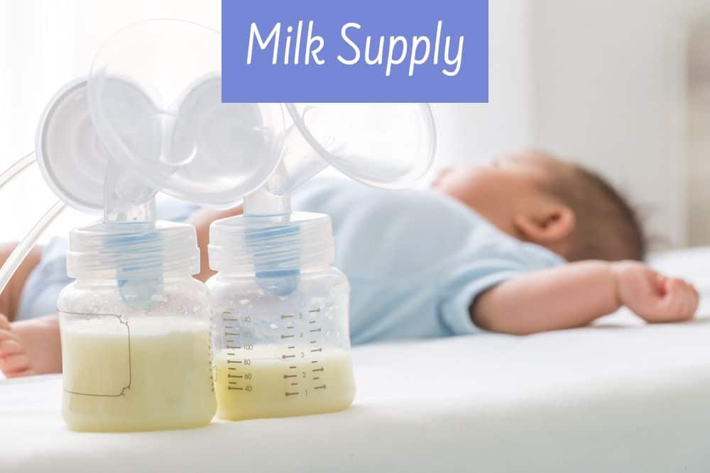 bottles of breast milk and baby in background