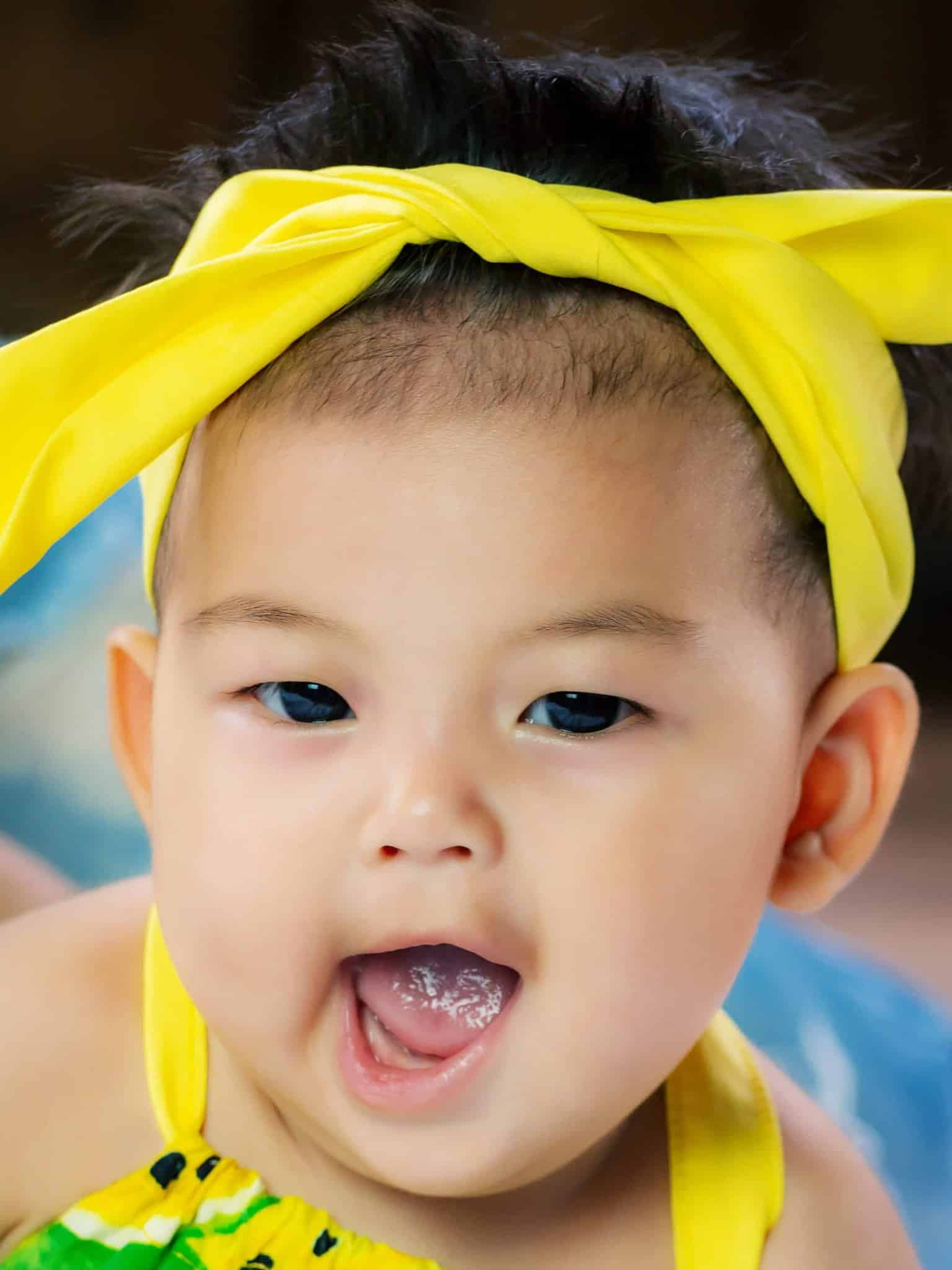 asian baby girl with white patches on her tongue