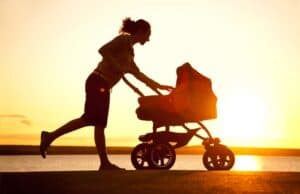 woman running with baby carriage