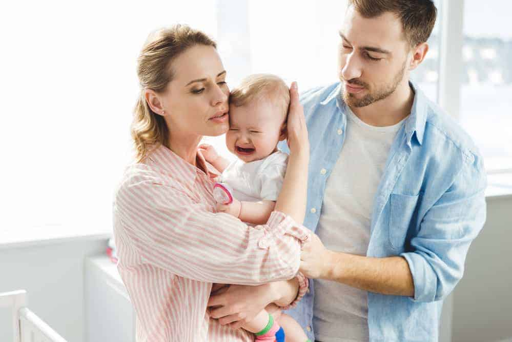 parents with crying baby