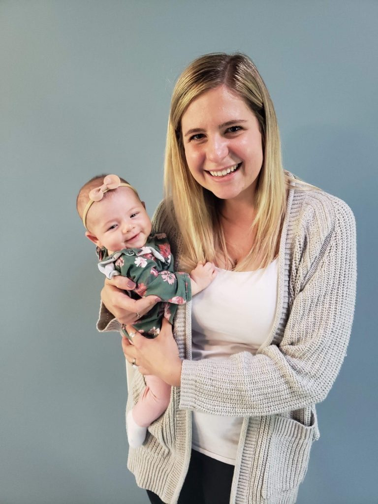 smiling woman holding baby girl
