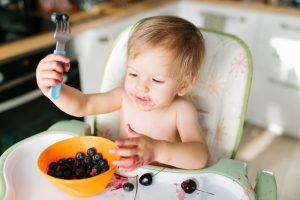 baby eating with baby led weaning method